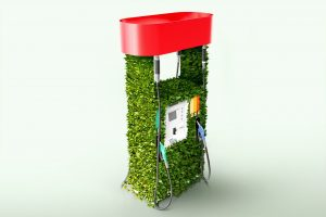 gas pump covered in green leaves