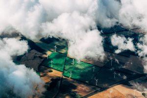 wind energy turbines under clouds
