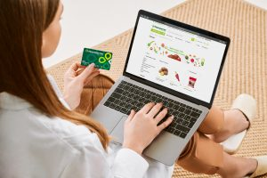 e-commerce online grocery shopping woman paying with card